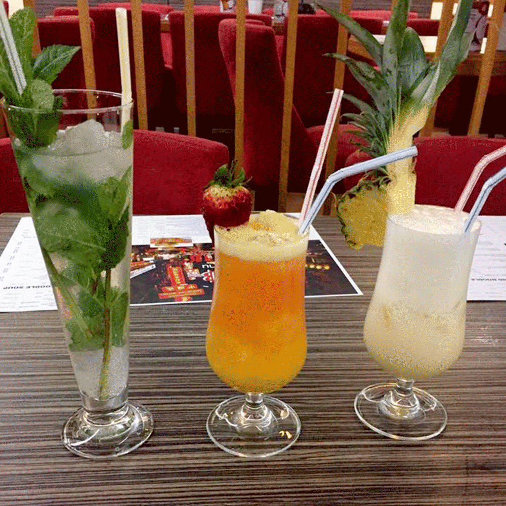 Trio of cocktails with fruit